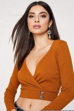 See Long Sleeve Surplice Cropped Top With Button Detail in Terracotta