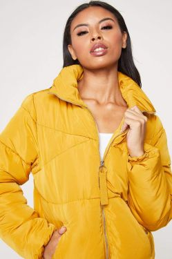 See Boxy Puffer Jacket in Mustard