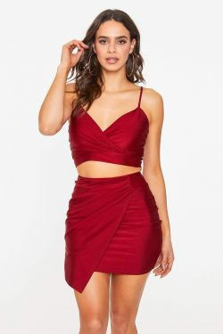 See Asymmetrical Pleated Overlay Skirt in Burgundy